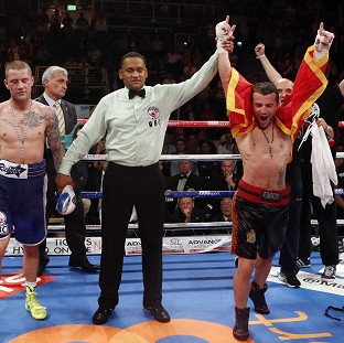 Ricky Burns, left, lost by split decision to Dejan Zlaticanin, right
