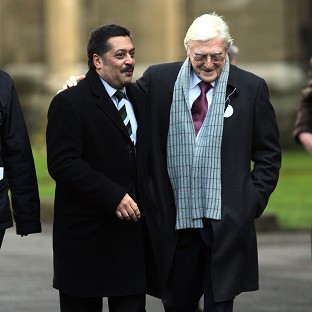 Damian D'Oliveira, pictured left with Sir Michael Parkinson, has died aged 53