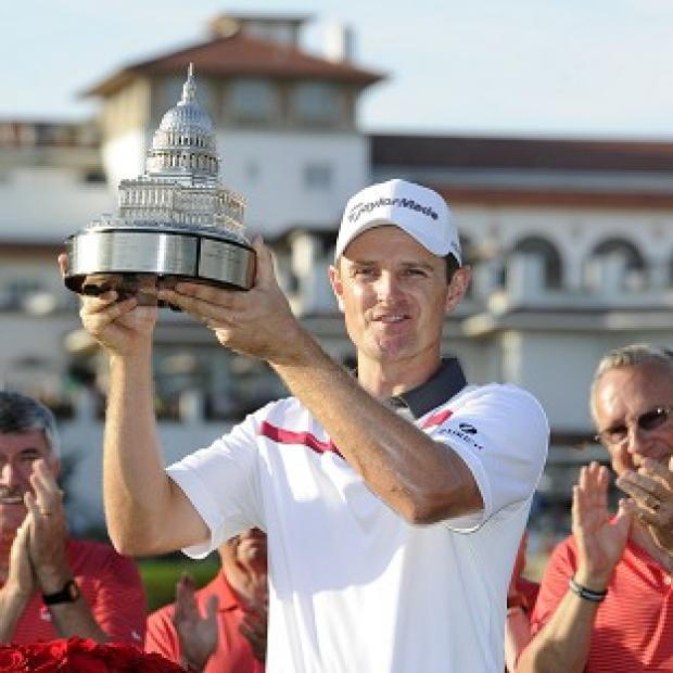 Salisbury Journal: Justin Rose poses with the trophy at the Quicken Loans National (AP)