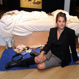 Tracey Emin with her work My Bed
