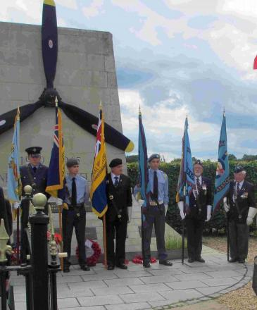 Dignitaries and servicemen gather for service at Holmsley