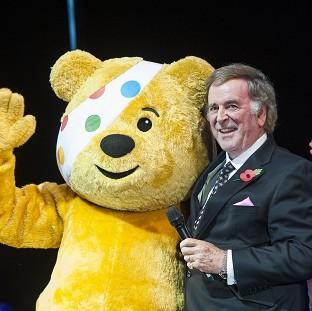 Sir Terry Wogan with Children In Need mascot Pudsey bear