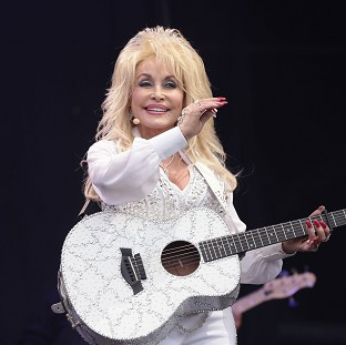 Dolly Parton performing on the Pyramid Stage at the Glastonbury Festival, at Worthy Farm in Somerset.