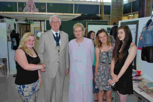 Dorset County Council chairman John Wilson and his wife with Ferndown Upper School students Rai Burroughs, left, from Verwood, Shola Pitman, and right, Phoebe Green from West Moors
