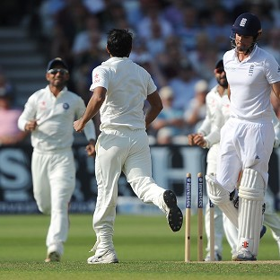 Alastair Cook trudges off as India celebrate his wicket