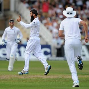 Moeen Ali, centre right, made an early breakthrough for England