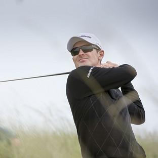Justin Rose holds a share of the lead at the Aberdeen Asset Management Scottish Open
