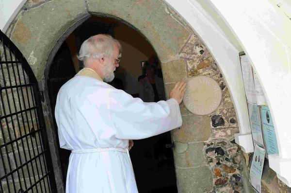 Dr Rowan Williams blesses a special engraving dedicated to George Herbert at St Andrew's Church