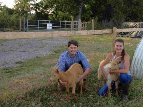 Nick Crowe and Sophia Fletcher with their goats at Sequoia Farm. The access they have been allowed to keep is behind them