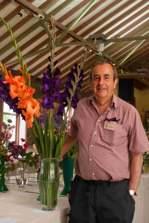 Chairman David Mussell with gladioli.To see lots more photos from this event click 'Buy this photo'.