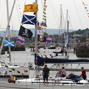The largest flotilla ever seen on the River Clyde sails into Glasgow as part of the city's Commonwealth Games celebrations
