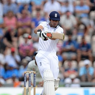 England captain Alastair Cook rode his luck to notch a half-century