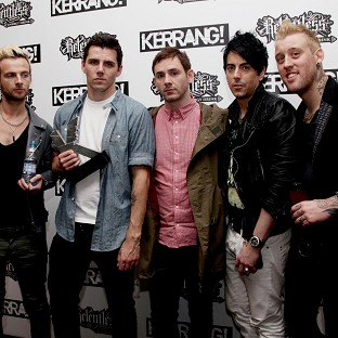 Former members of Lostprophets have discussed their reaction to Ian Watkins (second from right) being convicted of paedophilia