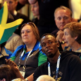 Usain Bolt watched Jamaica's Reggae Girlz in netball action on Wednesday after the furore over his opinion of the Games