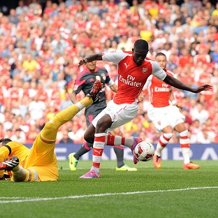 Yaya Sanogo, right, scores his first for Arsenal in the win over Benfica