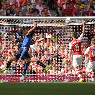 Radamel Falcao, in blue, scores his goal for Monaco against Arsenal