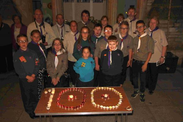 Beavers, cubs, scouts, explorer scouts and leaders of the 2nd Salisbury (Special Needs) Scout group commemorate the anniversary of Britain declaring war on Germany outside the United Reformed Church in Fisherton Street, Salisbury with their display of 100