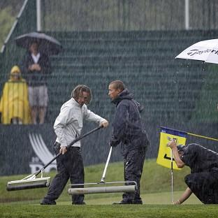 Torrential rain forced play to be suspended after just 20 minutes at Valhalla on Friday (AP)
