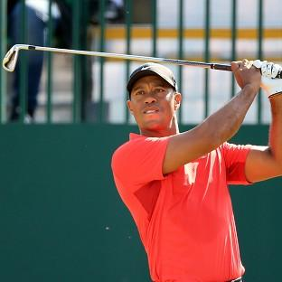 Tiger Woods suffered more pain and an early exit on Friday