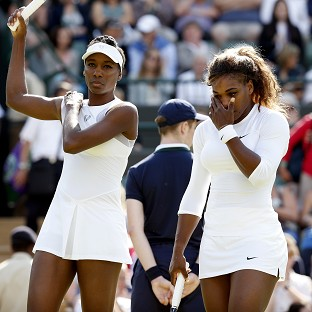 Venus Williams, left, managed to get the better of her sister Serena, right