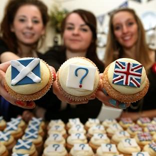 Hannah Vigers, Kim Simmonds and Lauren Blowes from Edinburgh baker Cuckoos at the launch of their referendum opinion poll survey, where you can buy your Yes, No or Undecided cupcake