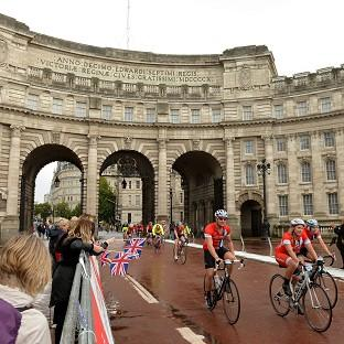 Cyclists make their way through Admiralty Arch on The Mall in the Prudential RideLondon-Surrey 100