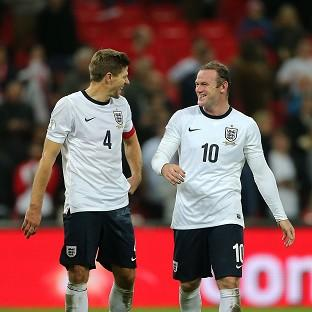 Wayne Rooney, right, is favourite to s