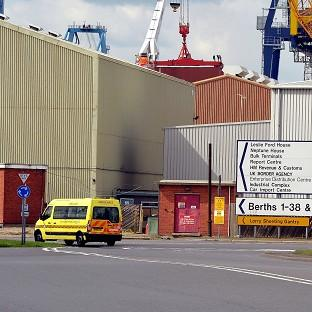 An ambulance van drives into Tilbury Docks in Essex, where