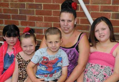 Fined mother slams school holiday policy