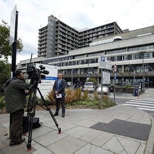 Media gather outside the Royal Free Hospital, where a British volunteer nurse who contracted Ebola is being treated