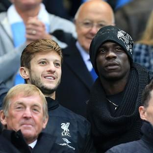 Mario Balotelli, right, was in Manchester to watch his new team play