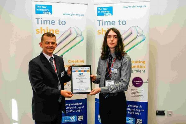 Innovative Ben Weeks (right) receives his award from Dr Jered Bolton, chairman of the panel of judges