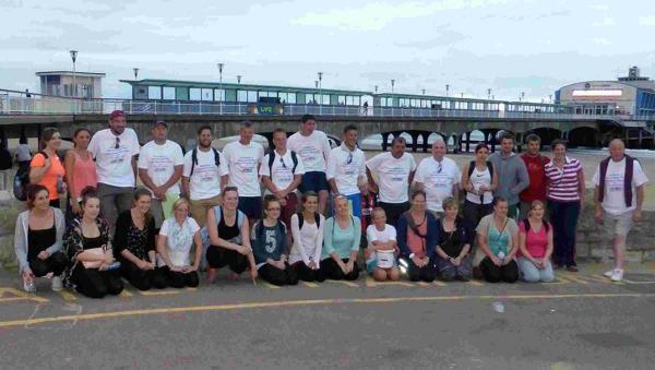 The walkers relax at Bournemouth Pier after trekking from Durdle Door for the Piam Brown Ward