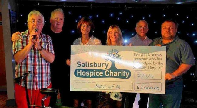 Music4fun raises £2,000. From left, Yan Webber, Andy Marks, Celia Scott (of Salisbury Hospice), Terri Johnson, George Mathers and Steve Edwards