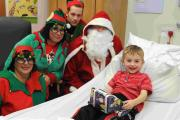Santa and elves deliver gifts to children's ward