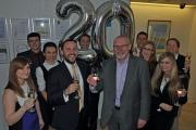 Celebrating success: Nigel Smith, Managing Partner (fifth right) and William Fox Bregman, Partner (fourth left), join members of Ellis Jones'  banking and finance litigation department to toast the £20 million reclaimed for clients