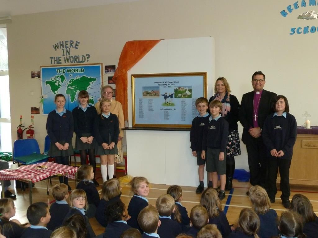 Pupils pictured with Shirley Ellicott, the Bishop of Southampton, the Rt Revd Jonathan Frost, head teacher Emma Clark and the bicentenary banner.