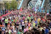 Marathon runners make their way over Tower Bridge during the 2015 Virgin Money London Marathon. PRESS ASSOCIATION Photo. Picture date: Sunday April 26, 2015. See PA story ATHLETICS London. Photo credit should read: Adam Davy/PA Wire (24599469)