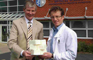 Professor Hattersley (left) and Dr Tim Frayling of the Peninsula Medical School in Exeter, with three kilogrammes of lard, the equivalent increase in weight shown by people with the rogue gene identified by the research.