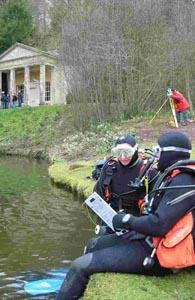 Two of the divers swap notes during the search.