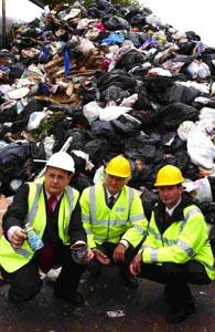 Salisbury District Council leader Paul Sample (left), environment and transport portfolio-holder James Robertson (centre) and cabinet member Paul Clegg visit the Hills waste transfer site at Thorny Down. The waste pictured has already been compacted four