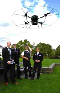 Mark Lawrence shows the capabilities of the AirRobot to Sgt Chris Bevan, PCSO Sam Spacey and PCSO Lorraine Rice. DB3036P5