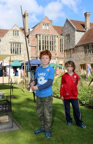 Salisbury Journal: Alastair Meechan, nine, holding a Handhalf Knight's sword with his sister Eliza, seven, at the Festival of Archaeology at Salisbury Museum. Picture by Spencer Mulholland