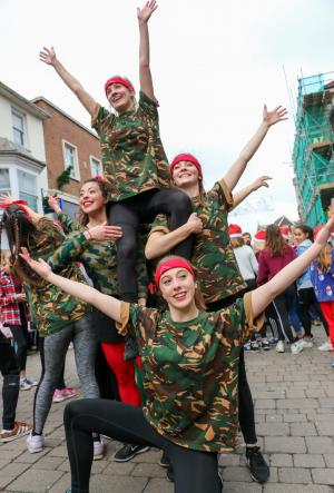 Salisbury Journal: A festive flash mob of dancers entertain visitors in the city centre. Picture by Spencer Mulholland