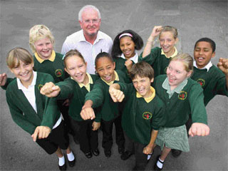 CELEBRATING: Head teacher Robert Carson with some of his pupils.