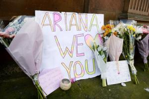 Tributes left outside St Ann's Church in Manchester, the morning after a suicide bomber killed 22 people, including children, as an explosion tore through fans leaving a pop concert, at Manchester Arena. PRESS ASSOCIATION Photo. Picture date: Tuesday