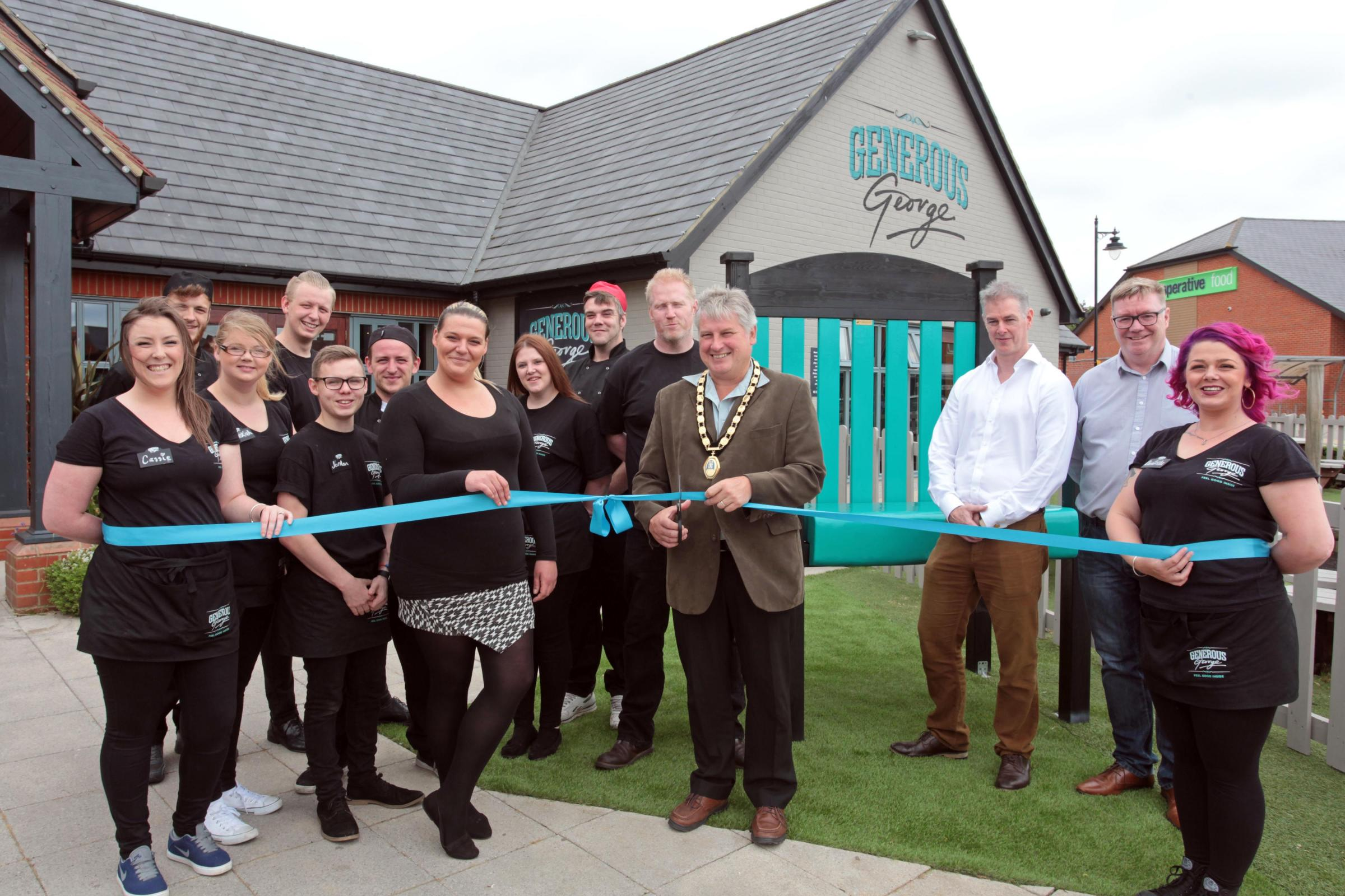Cassie Kirkdale, Charlie Bell, Rebekah Killick, Josh Harris, Jordan Cuthbertson,  Liam Hoffman, Sammy Sart,  Becca Seagrave, Tony Downey, Paul Brennan with Mayor, Andrew Williams, Iain Jackson, MD Keith Hitchens and Danielle Davies at the reopened Orchard