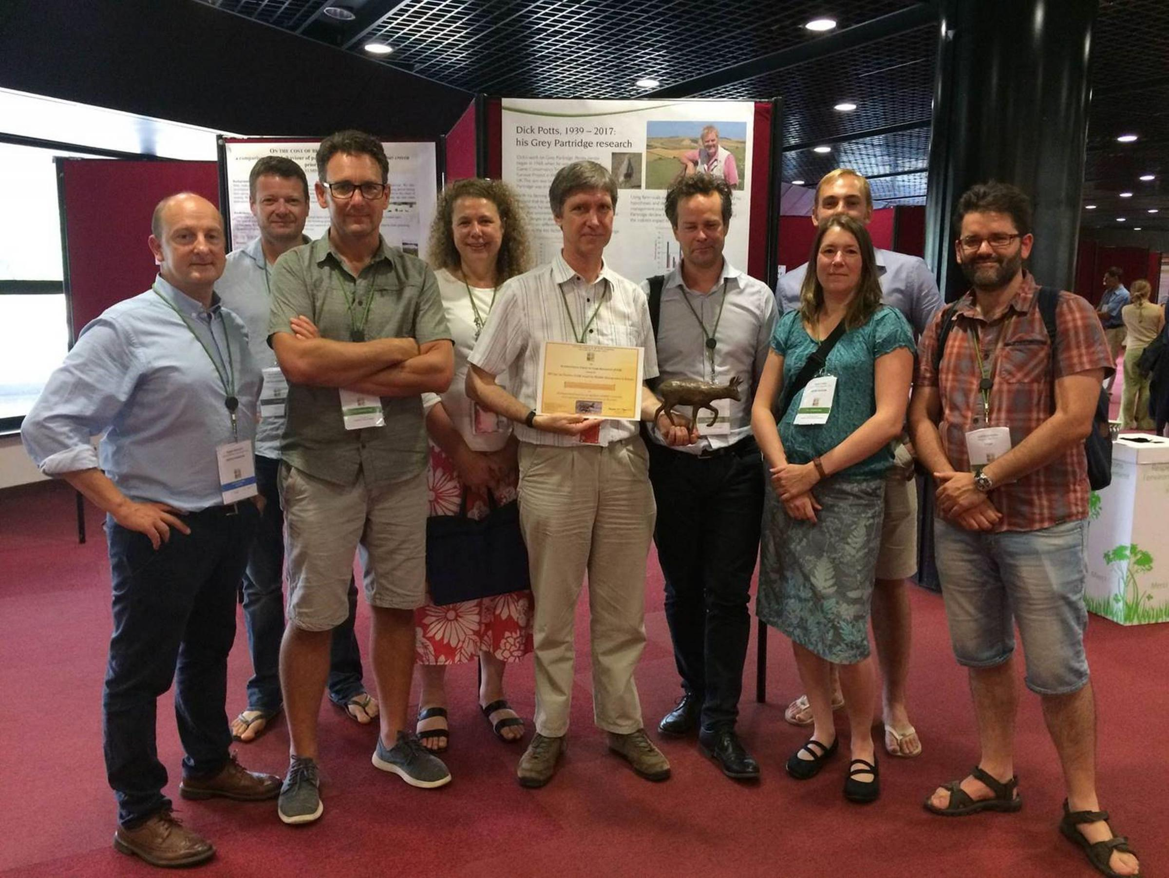 Game and Wildlife Conservation Trust scientists with the award in Montpellier