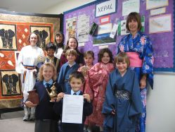 Children celebrate the International School Award