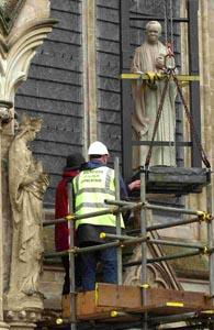 The statue of Canon Ezra being installed on the west front of Salisbury Cathedral. DB4424P06
